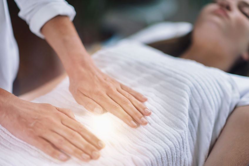 Reiki Healing Treatment performed by female therapist