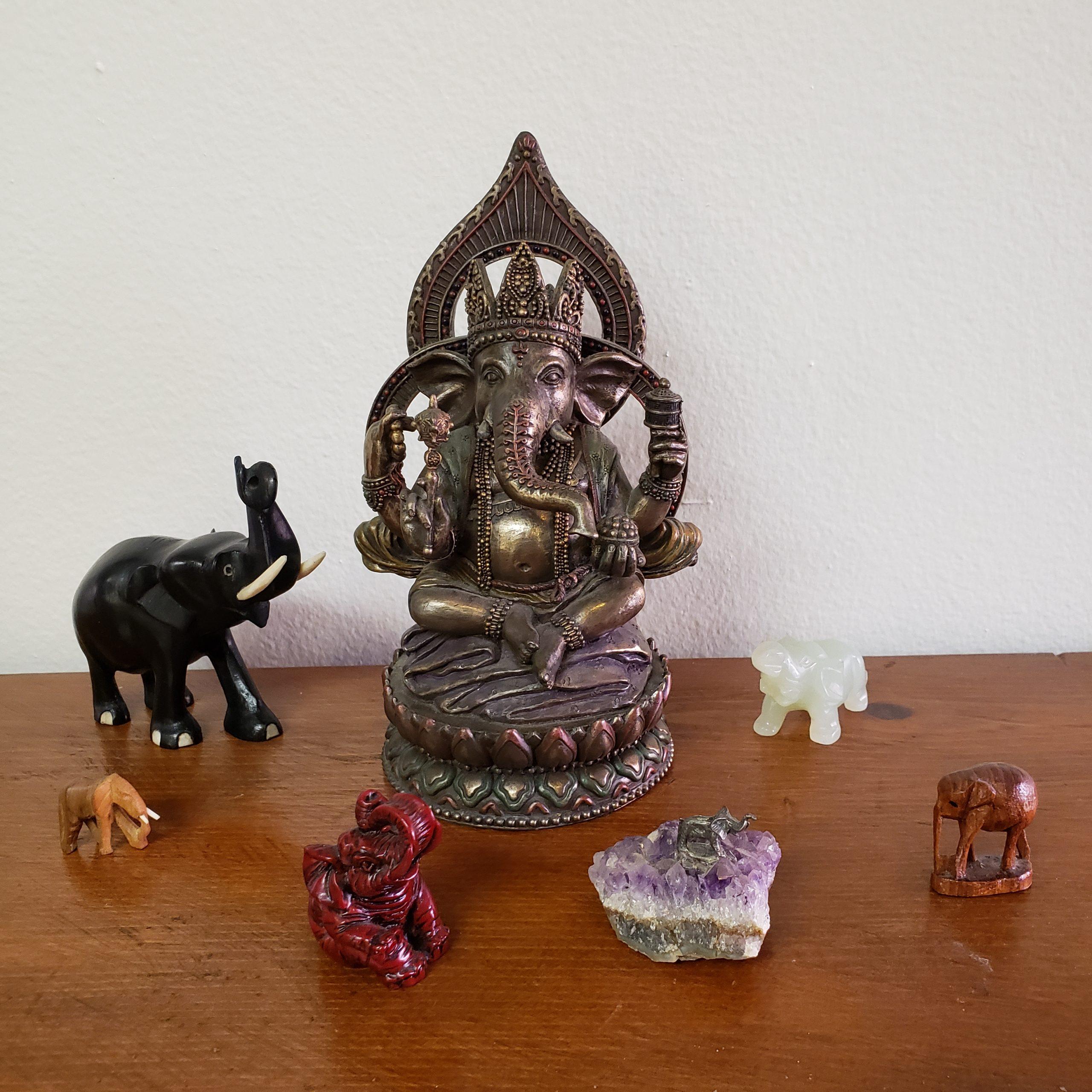 Ganesha and elephant figurines.
